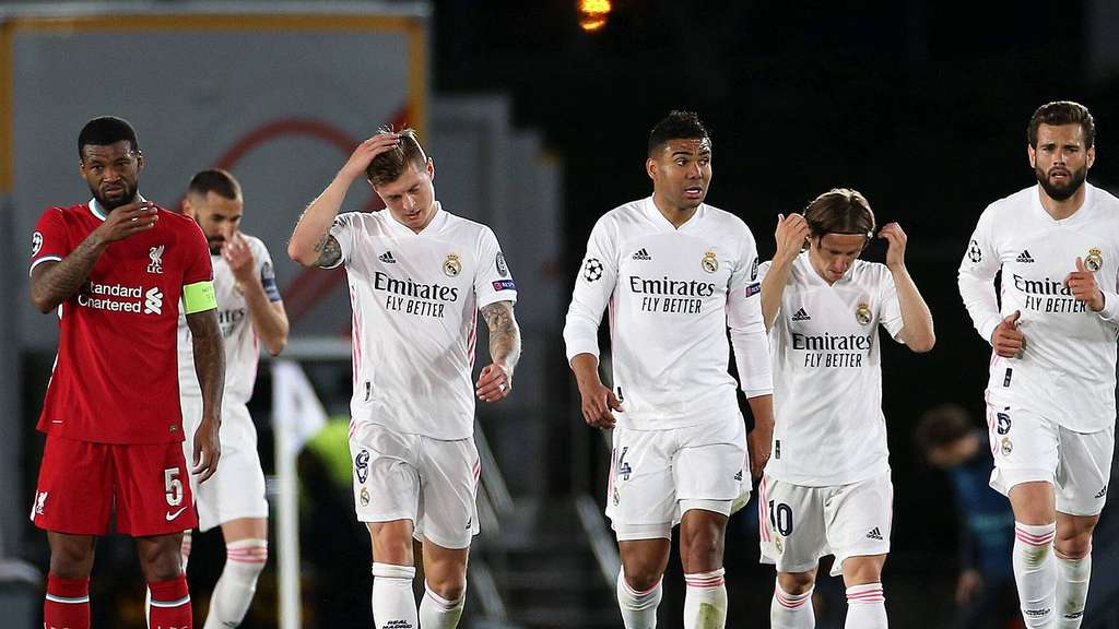 Stadium Liverpool s Georginio Wijnaldum (left) appears dejected as Madrid players celebrate their side s second goal of the game
